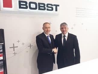 Emilio Corti (links), Vertriebsleiter Bobst Business Unit Sheet-fed und Eduardo Posada (rechts), CEO Grupo Grondi, Bobst Group, Flexodruckmaschine, Kaschierung, Preprint, Verpackungen
